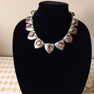 Silver necklace with amber glass and rinestones.